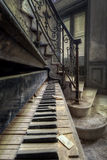 Rotten Piano. A piano left all alone somewhere in an abandoned castle in France royalty free stock photo