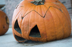Rotten Pumpkin. A Jack O Lantern is beginning to decay Stock Photos