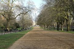 Rotten row bridle path in  hyde park London. Rotten Row, a broad track running for  along the south side of Hyde Park in London, a place to ride horses in the Stock Photo