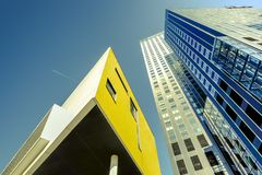 Rotterdam architecture in a low angle. Color shift by intent. Rotterdam architecture in a low angle under aclear blue sky. Color shift by intent royalty free stock photography