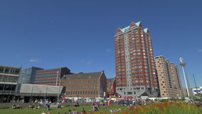 Rotterdam architecture, view with Central Library and St. Lawrence Church. ROTTERDAM, NETHERLANDS - AUGUST 05, 2016: Panning shot of city with apartment blocks stock video