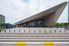 Rotterdam Centraal Station modern building. Rotterdam, Netherlands - June 9, 2014: Centraal Station modern building front view with a crosswalk in the foreground Royalty Free Stock Photos