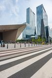 Rotterdam Centraal Station and skyscrapers. Rotterdam, Netherlands - June 9, 2014: Centraal Station modern building and glass skyscrapers with a crosswalk in the Royalty Free Stock Images