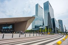 Rotterdam Centraal Station and skyscrapers. Rotterdam, Netherlands - June 9, 2014: Centraal Station modern building and glass skyscrapers with a crosswalk in the Royalty Free Stock Photos