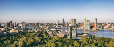Rotterdam Netherlands cityscape and Erasmus bridge. Panoramic view from Euromast tower, sunny day. Rotterdam city aerial view. Panorama of Rotterdam city, river royalty free stock images