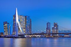 The iconic Erasmusbrug at twilight in Rotterdam, The Netherlands. ROTTERDAM- FEBRUARY 7, 2018. The Erasmus Bridge at dusk. The 284m long bridge was designed by Royalty Free Stock Photo