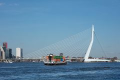 The 800 meter long iconic Erasmusbrug on a sunny day, Rotterdam, Netherlands. ROTTERDAM-FEBRUARY 13, 2018. The 800 meter long Erasmus Bridge, built from light Stock Image