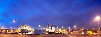Rotterdam Harbor. At night, with a view of the docks and the Erasmus Bridge and city skyline on the horizon Stock Photo