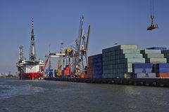 Rotterdam. Large harbor crane lifting a sea container Royalty Free Stock Images