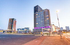 ROTTERDAM - MARCH 2015: City buildings near Erasmus Bridge at su. Nset. Rotterdam attracts 5 million tourists annually Stock Images
