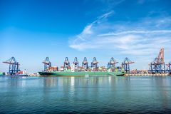 Rotterdam , Netherlands - April 20 2018 : Large harbor cranes loading container ships in the port of Rotterdam Royalty Free Stock Images
