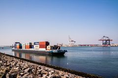 Rotterdam , Netherlands - April 20 2018 : Large harbor cranes loading container ships in the port of Rotterdam Royalty Free Stock Photos