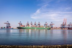 Rotterdam , Netherlands - April 20 2018 : Large harbor cranes loading container ships in the port of Rotterdam Stock Photography
