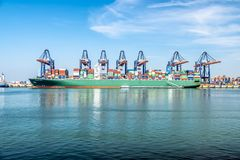Rotterdam , Netherlands - April 20 2018 : Large harbor cranes loading container ships in the port of Rotterdam Stock Images
