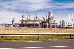 Rotterdam , Netherlands - April 20 2018 : Refinery plant of a petrochemical industry producing at Europort harbor royalty free stock photography