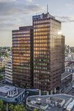 Purple office tower in the evening sun royalty free stock image