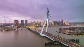 Rotterdam, Netherlands Skyline Time Lapse. Rotterdam, Netherlands, city skyline time lapse with Erasmus Bridge from dusk to night stock video