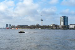 Euromast tower in Rotterdam with a taxi boat in the Meuse. Rotterdam, Netherlands - Dec 18, 2017 : Euromast tower with a taxi boat in the Meuse in the foreground Stock Images
