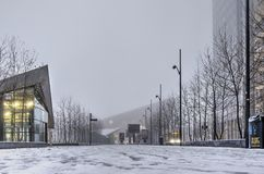 Snow in front of the Rotterdam central station royalty free stock image