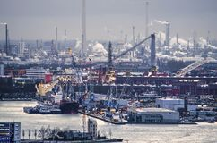 Harbour and refineries. Rotterdam, the Netherlands, February 2, 2018: harbour activities at Heijplaat and beyond it the refineries at Pernis Stock Images