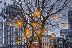 Lampions at the White House. Rotterdam, The Netherlands, February 11, 2018: Lanterns in a barren tree near the Old Habrbour with historic skyscraper the White Stock Image