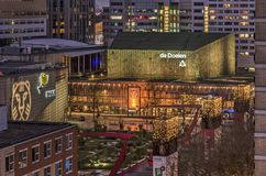 Theatre square at dusk. Rotterdam, The Netherlands, January 28, 2018: view at dusk of Schouwburgplein Theatre Square with Doelen concert hall and Pathe cinema Royalty Free Stock Photos