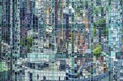 Reflection in a green curved facade stock photos