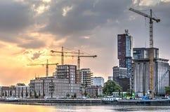 Construction cranes at sunset royalty free stock photos