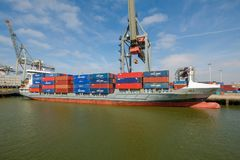 Sea container ship fully loaded in container terminal, Rotterdam royalty free stock photography