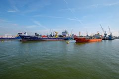 Two sea tankers docked at buoys in the Rotterdam harbor. stock photo