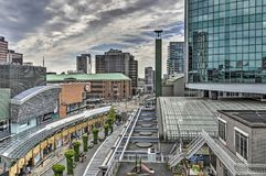 Shopping mall and world trade center. Rotterdam, The Netherlands, June 10, 2017: Aerial view of Koopgoot pedestrian shopping street and the green glass tower of Royalty Free Stock Image
