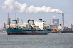 Cargo ship leaving Dutch harbor Rotterdam, biggest seaport of Europe stock photos