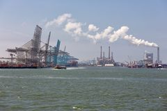 Container terminal with big cranes in Dutch harbor Rotterdam royalty free stock photography