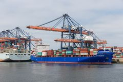 Container terminal in Dutch harbor Rotterdam with cargo ships moored royalty free stock images