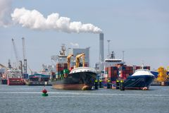 Container terminal in Dutch harbor Rotterdam with cargo ships moored royalty free stock photography