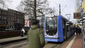 Tram arriving in Rotterdam City. Rotterdam, The Netherlands - March 10, 2017: RET tram arriving in Rotterdam city, the Netherlands stock video footage