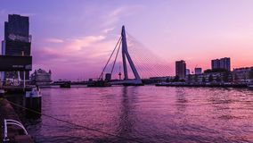 ROTTERDAM, NETHERLANDS - MAY 31, 2018: Erasmus bridge on the Maas river with the De Rotterdam towers in the background Royalty Free Stock Photo