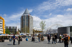 Rotterdam, Netherlands - May 9, 2015:  People around Pencil tower, cube houses and Blaak Station in Rotterdam Royalty Free Stock Image