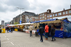 Rotterdam, Netherlands - May 9, 2015: Unidentified shoppers at the Street Market in Rotterdam. Royalty Free Stock Photo