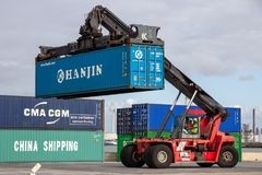 Mobile container handler shipping port terminal. ROTTERDAM, NETHERLANDS - SEP 6, 2015: Mobile container handler in action at a container terminal in the Port of royalty free stock photos