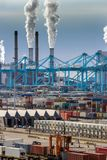 Port shipping container ternimal and chimney emission stock photo
