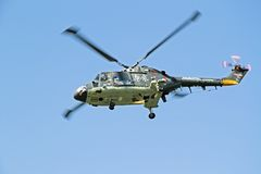 ROTTERDAM, NETHERLANDS - SEPTEMBER 09: Army helicopter is flying Royalty Free Stock Photo