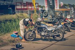 ROTTERDAM, NETHERLANDS - SEPTEMBER 2 2018: Motorcycles are shining at Dutch motor event 'Rotterdam Dirt Ride'. ROTTERDAM, NETHERLANDS - SEPTEMBER 2 2018 stock photo