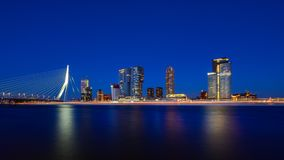 Rotterdam skyline cityscape by night , Erasmus bridge , Netherlands travel in Europe. Rotterdam skyline cityscape by night , travelling to Netherlands, Europa royalty free stock photos