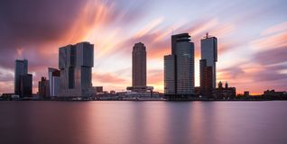 Rotterdam skyline at sunrise. Skyline of rotterdam with office buildings and cruise terminal at sunrise Stock Images