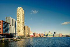 Rotterdam skyline in warm afternoon light. Under a blue sky. Color shift by intent stock images