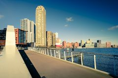 Rotterdam skyline, a bridge in the front. Rotterdam skyline in warm afternoon light under a blue sky. Color shift by intent royalty free stock photo