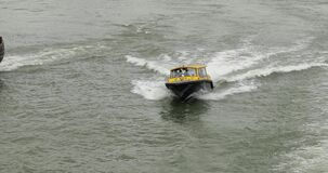 Rotterdam water taxi crossing the waters between cargo ships