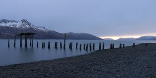 Rottin pier. Rotting pier in a remote region of Kodiak Island royalty free stock image