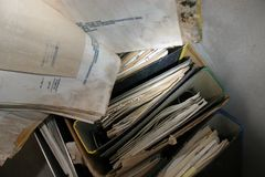 Rotting archives. Archive of old papers gone mouldy in a cellar, no words are legible Royalty Free Stock Photo